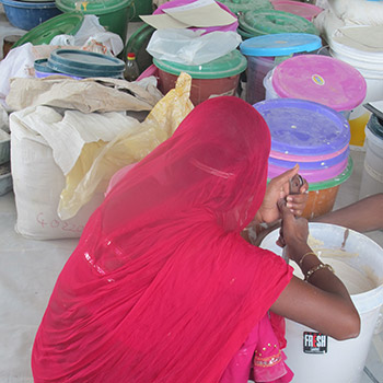 Preparing colour for Araash layers – New Delhi, Northern India