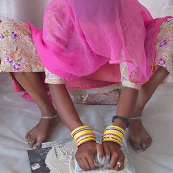 Straining slaked lime for Araash – New Delhi, Northern India