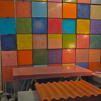 Coloured concrete 'wall' and tables