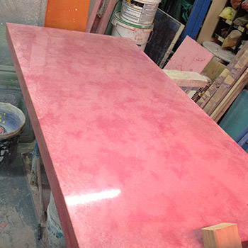 Rose madder concrete table top