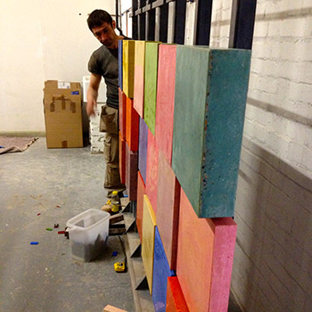 Constructing coloured concrete 'wall'