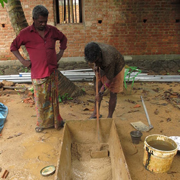 Making Lime and brickdust plaster for Araash – Kerala, South India