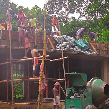 Mixing Concrete on Building site during Monsoon – Kerala, South India
