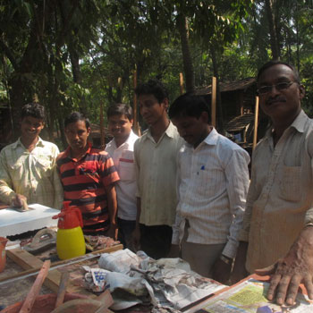 Men helping with Concrete samples – Ali Bagh, Western India