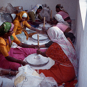 Grinding marble dust and slaked lime using chukkis for Araash work, Mumbai, India