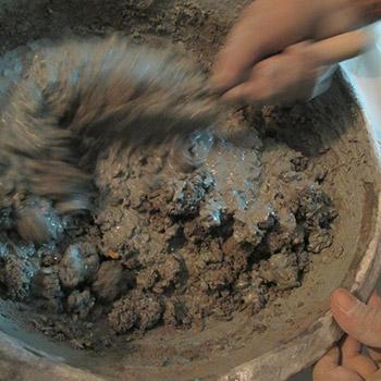 Mixing a sample of Brick/lime mortar – Kerala, South India