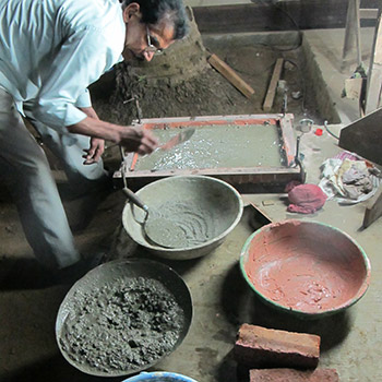 Preparing coloured concrete sample blocks – workshop, Ali Bagh, Western India
