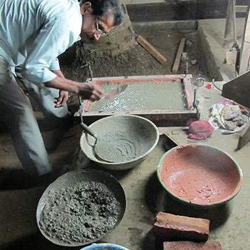 Preparing coloured concrete sample blocks – workshop, Ali Bagh, Western India