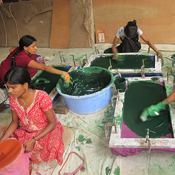 Straining Colour and lime for concrete render – Workshop, Ali Bagh, Western India