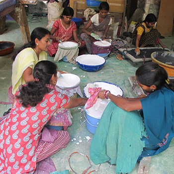 Straining Lime and Colour for cement render – Workshop, Ali bagh, Western india