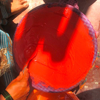 Straining Cadmium red Pigment and lime – Studio, West London