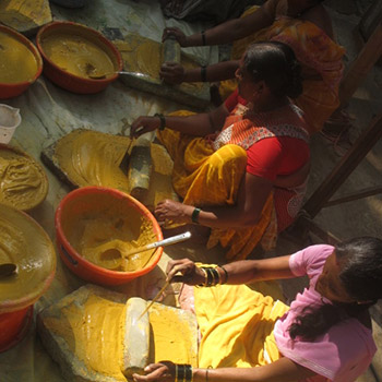 Women Grinding colour for concrete construction in Ahmadabad – Workshop, Ali bagh, Western India