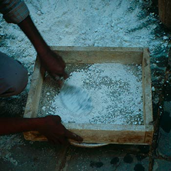 Sieving lime rock before slaking – Studio, Gujerat, western india
