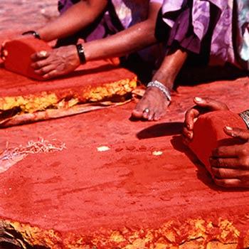 Grinding Cadmium reds for Araash wall – Indigo restaurant, Mumbai, India