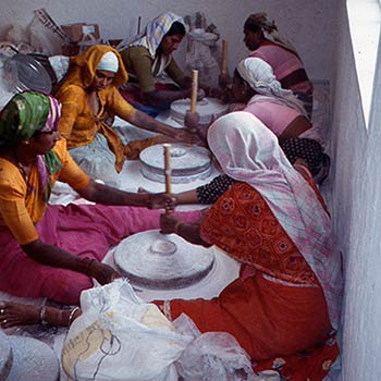 Grinding Marble dust and Slaked Lime for Araash, using Chukkis – Mumbai, India