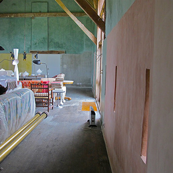 Coloured limewash walls using hand mixed lime based paint – Barn on Beaulieu Estate, Hampshire