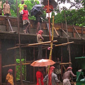 Mixing concrete during Monsoon, site Project using off White Araash – Kerala, South India