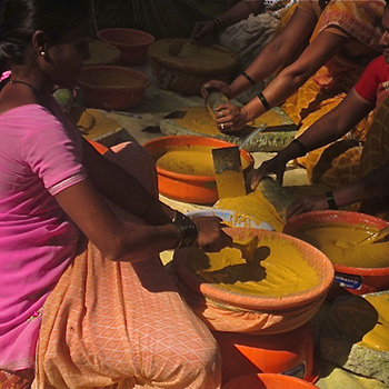 Straining and preparing colour for Ahmedabad site, Western India