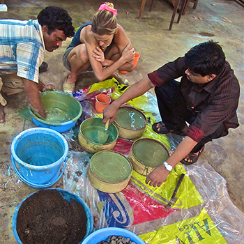 Measuring and mixing ingredients for poured concrete blocks – Studio, Ali Bagh, Western India